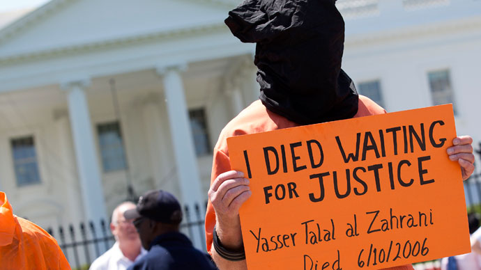 An activist wearing an orange jumpsuit marks the 100th day of prisoners' hunger strike at Guantanamo Bay during a protest in front of the White House in Washington .(Reuters / Joshua Roberts)