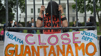 A hooded demonstrator is seen at a protest calling for the closure of the Guntanamo Bay detention facility infront of the White House on May 18, 2013 in Washington, DC. (AFP Photo / Mandel Ngan)