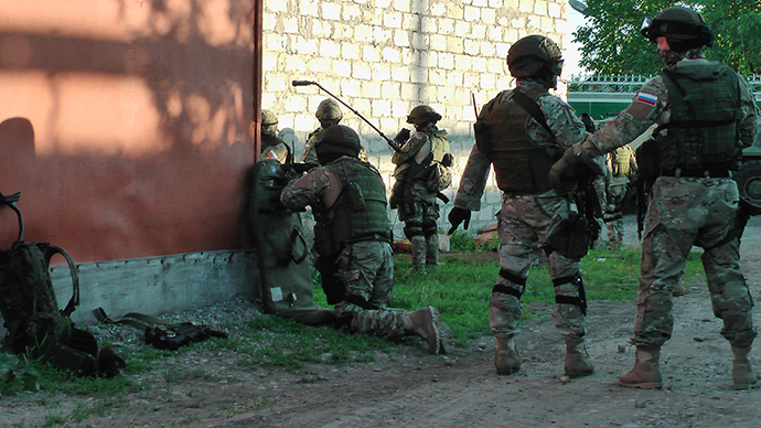 Russian Special Forces troops surround a building, in which two armed men identified as terrorist militants are hiding, in Nazran District of the North Caucasus Republic of Ingushetia on May 21, 2013. Photo: National Antiterrorism Committee (NAC)