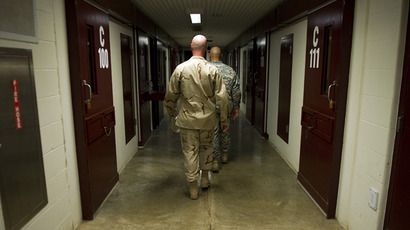 "This image reviewed by the US military shows members of the military walking the hallway of Cell Block C in the ""Camp Five"" detention facility of the Joint Detention Group at the US Naval Station in Guantanamo Bay, Cuba (AFP Photo / Jim Watson)"