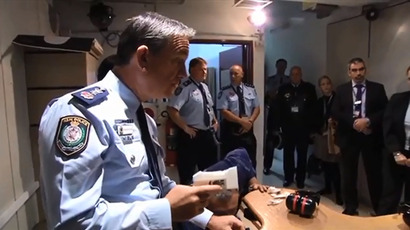 An officer from the NWS Police holding the remnants of a Liberator pistol after it exploded upon testing. Image taken from NSWPolice YouTube channel.