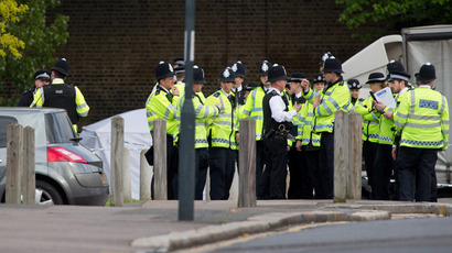Police officers man a cordoned off area in Woolwich, east London, on May 22, 2013, following an incident in which a man was killed and two others seriously injured  (AFP Photo / Leon Neal)