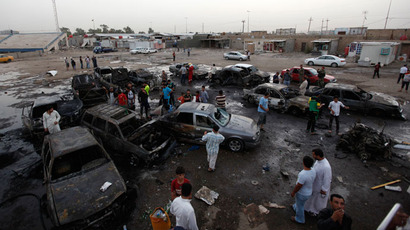 Residents gather at the site of a car bomb attack in Baghdad's Sadr City May 27, 2013.(Reuters / Thaier al-Sudani)