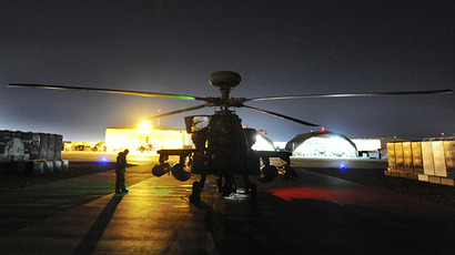 The Apache helicopter is seen being prepared before a night mission from Camp Bastion, southern Afghanistan. (Reuters)