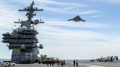 X-47B Unmanned Combat Air System (UCAS) demonstrator flying over the aircraft carrier USS George H.W. Bush (CVN 77).(AFP Photo / Alan Radecki)
