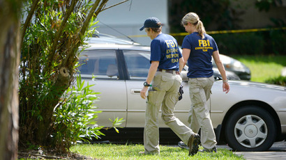FBI personnel walk through the complex surrounding the apartment, where Ibragim Todashev, 27, was shot and killed by FBI, in Orlando, Florida, May 22, 2013. (Reuters / Phelan Ebenehack)