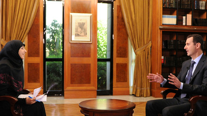 Syria's President Bashar al-Assad (R) gestures during an interview with al-Manar TV in Damascus, in this handout photograph distributed by Syria's national news agency SANA, on May 30,2013 (Reuters)