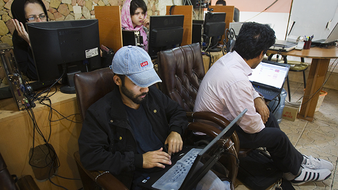 Customers use computers at an internet cafe in Tehran. (Reuters / Raheb Homavandi)