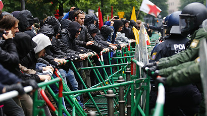 "Riot police try to prevent protestors from breaking through barricades near the European Central Bank (ECB) headquarters during an anti-capitalist ""Blockupy"" demonstration in Frankfurt, May 31, 2013. (Reuters / Kai Pfaffenbach)"