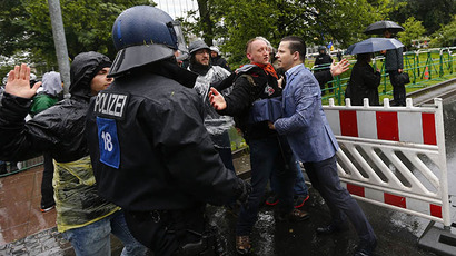 "Protestors try to stop a man from entering the blockade around the European Central Bank (ECB) headquarters during an anti-capitalism ""Blockupy"" demonstration in Frankfurt, May 31, 2013. (Reuters / Kai Pfaffenbach)"