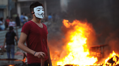 A demonstrator wears a Guy Fawkes mask as protestors clash with Turkish riot policemen  during a protest against the demolition of the Taksim Gezi Park, in Taksim Square, in Istanbul (AFP Photo / Bulent Kilic)
