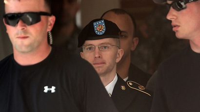 U.S. Army Private First Class Bradley Manning (C) is escorted as he leaves a military court for the day June 3, 2013 at Fort Meade in Maryland. (Alex Wong/Getty Images/AFP)