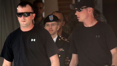 US Army Private First Class Bradley Manning is escorted as he leaves a military court for the day June 3, 2013 (AFP Photo / Alex Wong)