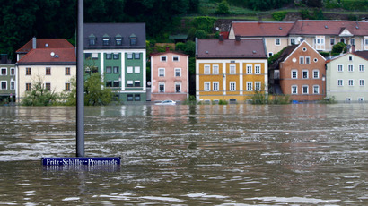 A street sign is partially submerged in the flooded centre of the Bavarian town of Passau, about 200 km north-east of Munich June 3, 2013 (Reuters / Michaela Rehle)