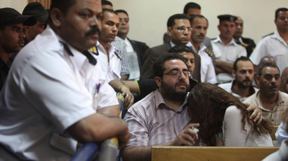 Friends of Egyptian suspects react as they listen to the judge's verdict at a court room during a case against foreign non-governmental organisations (NGOs) in Cairo June 4, 2013 (Reuters / Asmaa Waguih)