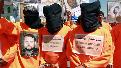 Yemenis wearing orange jumpsuits, similar to those worn by prisoners at the US detention centre in Guantanamo Bay, hold a protest demanding the release of inmates on hunger strike, on April 16, 2013  outside the US embassy in Sanaa. (AFP Photo / Mohammed Huwais)
