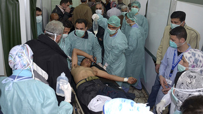 A man, wounded in what the government said was a chemical weapons attack, is treated at a hospital in the Syrian city of Aleppo March 19, 2013. (Reuters / George Ourfalian)