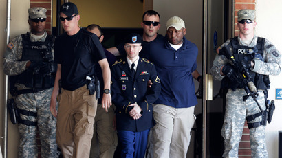 U.S. Army Private First Class Bradley Manning (3rd L) departs after day two of his court-martial at Fort Meade, Maryland June 4, 2013 (Reuters / Gary Cameron)