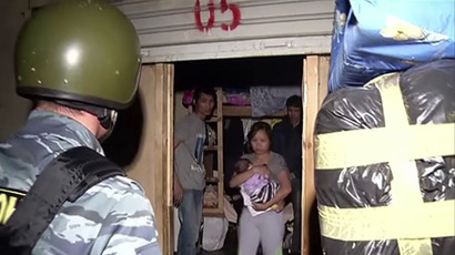 Moscow police raid illegal underground migrant 'city' (screenshot from AFP video)