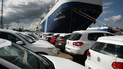 German Volkswagen cars standing at the car terminal in front of a cargo ship at the harbour of Bremerhaven, northern Germany. (AFP Photo / Patrick Stollarz)