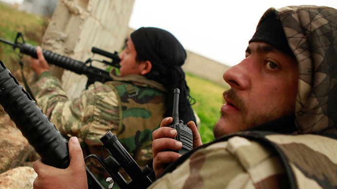 Britain arming Syrian rebels would face MP vote