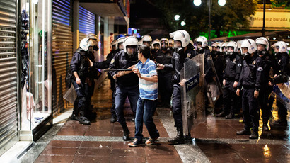 A demonstrator is detained by police during a demonstration in Kizilay square in Ankara on June 9, 2013.(AFP Photo / Marco Longari)