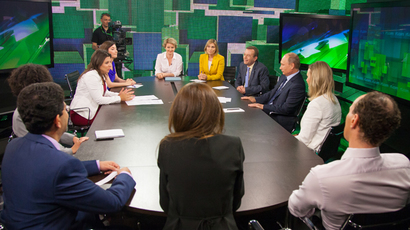 Russian President Vladimir Putin during his talk with Russia Today television channel's journalists and correspondents, June 11, 2013. (RT photo / Semyon Khorunzhy)