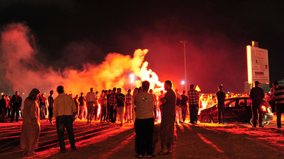 Protesters block the road and set off fireworks, after they burned two vehicles belonging to the Libyan Army's First Infantry Brigade in Benghazi June 14, 2013. (Reuters/Esam Al-Fetori)