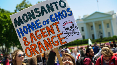 People hold signs during a demonstration against agribusiness giant Monsanto and genetically modified organisms (GMO) in front of the White House in Washington on May 25, 2013. (AFP Photo)