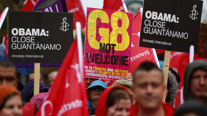 People take part in a demonstration against the upcoming G8 summit, to be held near Enniskillen, in Belfast June 15, 2013. (Reuters)