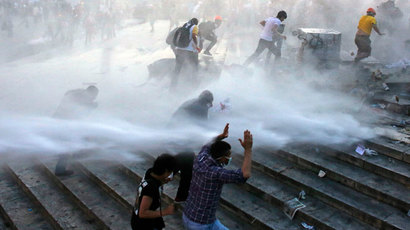 People run as riot police fires a water cannon on Gezi Park protesters at Taksim Square in Istanbul June 15, 2013.(Reuters / Murad Sezer)