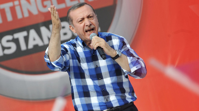 Turkish Prime Minister Recep Tayyip Erdogan makes a speach to supporters during a rally on June 16, 2013, in Istanbul (AFP Photo / Ozan Kose)