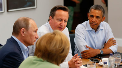 Country leaders Germany's Chancellor Angela Merkel, Russia's President Vladimir Putin (L), Britain's Prime Minister David Cameron (C) and U.S. President Barack Obama (R) attend a working session at the Lough Erne golf resort where the G8 summit is taking place in Enniskillen, Northern Ireland June 18, 2013.(Reuters / Yves Herman)