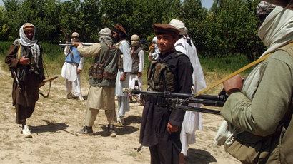 Taliban fighters are seen in an undisclosed location in Afghanistan July 14, 2009.(Reuters / Stringer)