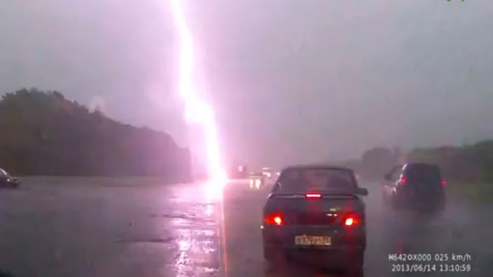 Caught on dash cam: Lightning hits mother and her child on highway