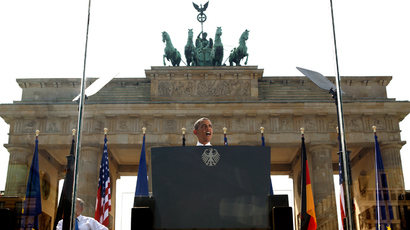 From behind a bullet-proof glass, U.S. President Barack Obama speaks in front of the Brandenburg Gate in Berlin, Germany June 19, 2013 (Reuters / Kevin Lamarque)
