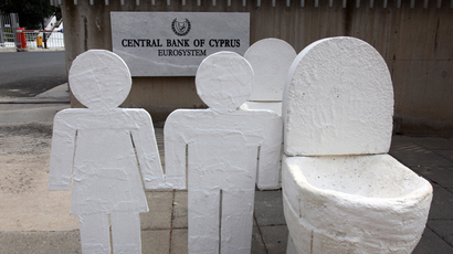 An artwork of plaster toilets by Cypriot artist Andreas Efstathiou is displayed outside the Cyprus Central Bank in Nicosia (AFP Photo / Barbara Laborde)