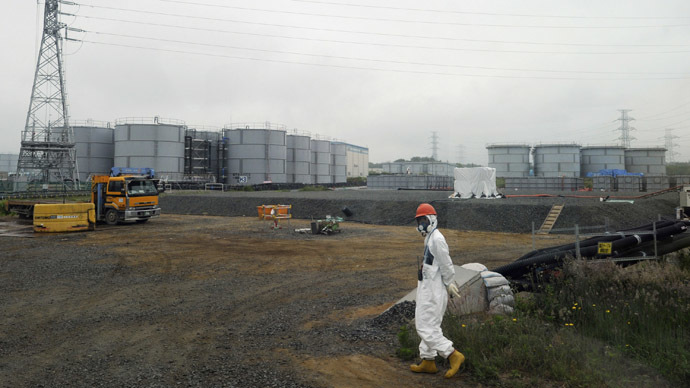 A construction worker walks beside the underground water tank and water tanks at Tokyo Electric Power Company's (TEPCO) tsunami-crippled Fukushima Daiichi nuclear power plant in Fukushima prefecture June 12, 2013. (Reuters/Toshifumi Kitamura)