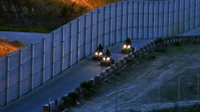 U.S. Customs and Border Patrol agents patrol along the international border between Mexico and the United States near San Diego, California (Reuters/Mike Blake )