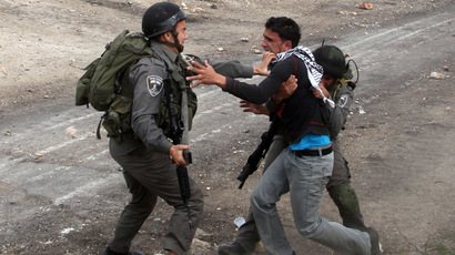Israeli border guard detain a Palestinian during clashes following a protest against the against the expropriation of Palestinian land by Israel on March 1, 2013, in the village of Kafr Qaddum, near the occupied West Bank city of Nablus. (AFP Photo)
