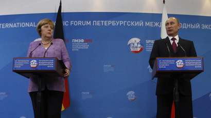 No agreement in sight. Russia's President Vladimir Putin (R) and Germany's Chancellor Angela Merkel attend a news conference after their meeting at the St. Petersburg International Economic Forum in St. Petersburg, June 21, 2013. (Reuters)