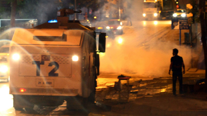 A riot police water cannon vechile stationed in the street while anti-government protesters stage a demonstration in Ankara, June 22, 2013 (AFP Photo / Adem Altan)