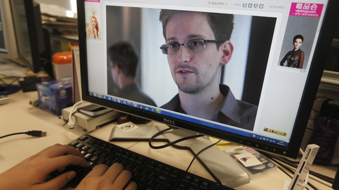A picture of Edward Snowden, a contractor at the National Security Agency (NSA), is seen on a computer screen displaying a page of a Chinese news website, in Beijing in this June 13, 2013 photo illustration. (Reuters/Jason Lee)