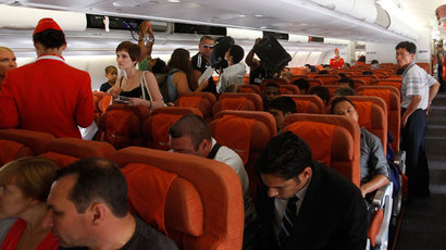 People sit onboard an Aeroflot plane heading to the Cuban capital Havana at Moscow's Sheremetyevo airport June 27, 2013.(Reuters / Maxim Shemetov)