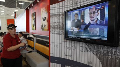 A television screens the image of former U.S. spy agency contractor Edward Snowden during a news bulletin at a cafe in Moscow's Sheremetyevo airport June 26, 2013. (Reuters)