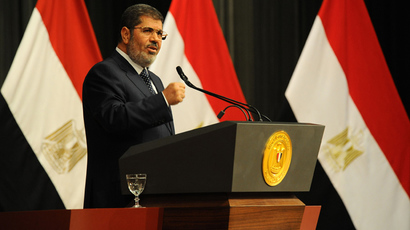 Mohammed Morsi addresses a conference to mark the upcoming anniversary of one year in power on June 26, 2013 in Cairo, Egypt (AFP Photo / HO / Egyptian Presidency)