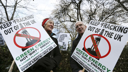 Demonstrators hold placards in protest against hydraulic fracturing for shale gas in London (AFP Photo / Justin Tallis)