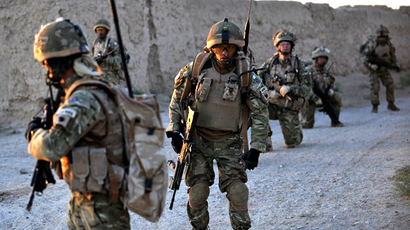 Soldiers from 1st Battalion the Royal Gurkha Rifles patrol through a village in Nahr e Saraj, Helmand, Afghanistan. (AFP Photo / Bay Ismoyo)