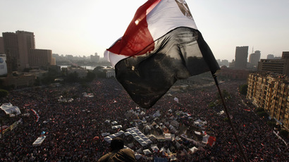 An Egyptian flag is seen as protesters opposing Egyptian President Mohamed Morsi shout slogans against him and Brotherhood members during a protest at Tahrir Square in Cairo June 30, 2013 (Reuters/Mohamed Abd El Ghany)