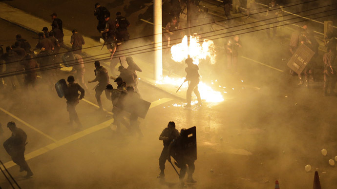 Riot police clash with demonstrators during a protest on the streets of Rio de Janeiro June 30, 2013. (Reuters)